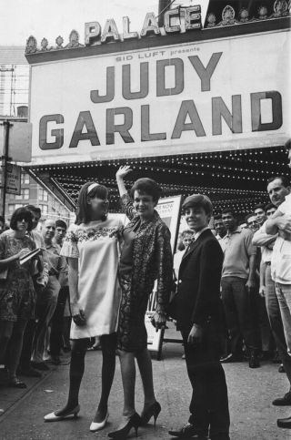 Judy Garland, flanked by her daughter Lorna Luft and son Joe Luft, outside The Palace Theater in New York, 1967