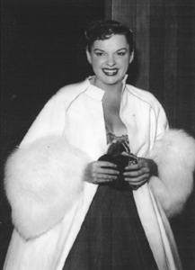 April 21, 1952: Judy arrives at the star-studded post-party celebrating her opening at The Los Angeles Philharmonic Auditorium.