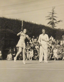 Judy Garland plays tennis with Lester Stoeffen in the background, April 21, 1940 at the Ambassador Hotel in Los Angeles