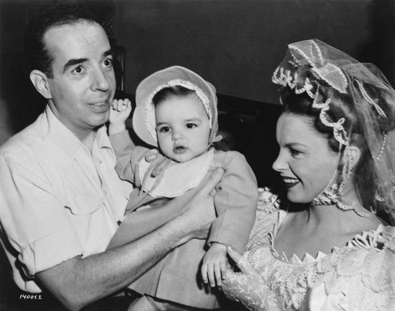 Baby Liza Minnelli visits her father, director Vincente Minnelli, and mother, Judy Garland, on the set of The Pirate, 1947
