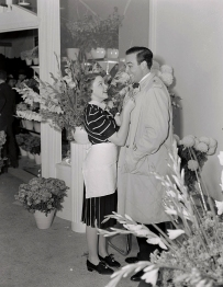 "Judy Garland and director George Sidney in her flower shop, ""Judy Garland Flowers"" early 1939"