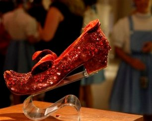 """Judy Garland's Arabian ruby slippers, one of five pairs believed designed by Adrian Greenberg of MGM studios and worn by Garland for test and wardrobe shots in the 1939 film """"The Wizard of Oz, """" are displayed at Saks Fifth Avenue in New York, Thursday, Sept. 4, 2008, part of an exhibit of ruby shoes created along the gemmed red slippers theme by well-known designers. The shoes, considered the most rare of all the ruby slippers used while making the film, are owned by Debbie Reynolds. (AP Photo/Kathy Willens)"""