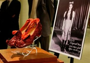 """Judy Garland's Arabian ruby slippers, one of five pairs designed by Adrian Greenberg of MGM studios and worn by Garland for test and wardrobe shots in the 1939 film """"The Wizard of Oz, """" are displayed at Saks Fifth Avenue in New York, Thursday, Sept. 4, 2008, part of an exhibit of ruby shoes created along the gemmed red slippers theme by well-known designers. Considered the most rare of all the ruby slippers used while making the film, the pair shown are owned by actress Debbie Reynolds. (AP Photo/Kathy Willens)"""