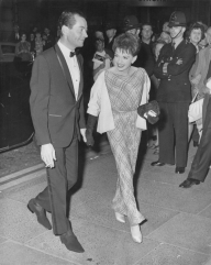 American actress and singer Judy Garland (1922 - 1969) and her partner Mark Herron attend the 'Night of 100 Stars' at the London Palladium, 23rd July 1964. Garland has just left a nursing home where she was being treated for injuries after an accident. (Photo by Keystone/Hulton Archive/Getty Images)