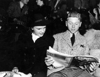 Mickey Rooney (1920 - ) the American film actor and Judy Garland (1922 - 1969) the American entertainer examine the programme at the Ice Follies. Original Publication: People Disc - HK0553 (Photo by Hulton Archive/Getty Images)